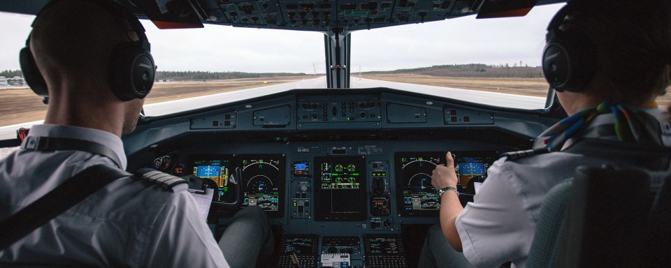 Commercial airline pilots in cockpit